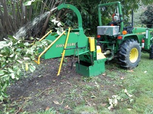 Chipper with new rotating chip chute